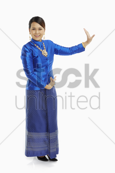 women in traditional clothing showing dance poses stock photo