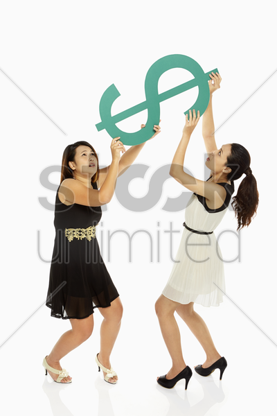 women lifting up a dollar sign stock photo