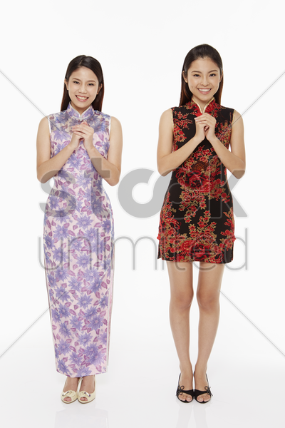 women showing greeting gesture stock photo