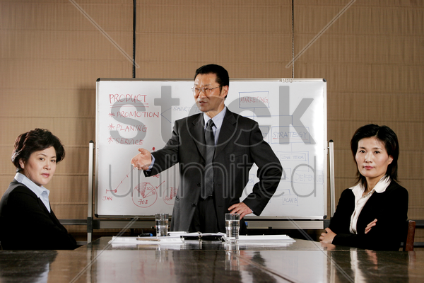 women showing their dissatisfaction towards their manager's presentation stock photo