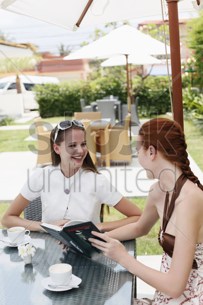 women smiling at each other stock photo