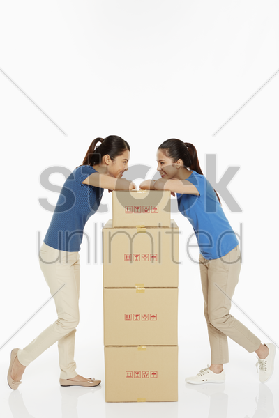 women standing and facing each other stock photo