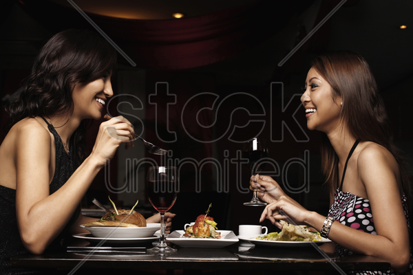 women talking while having a meal stock photo