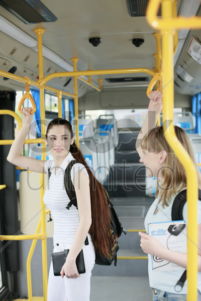 women travelling in a bus stock photo