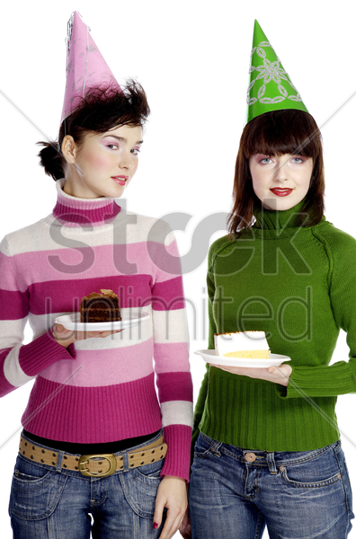 women with party hat holding cake stock photo