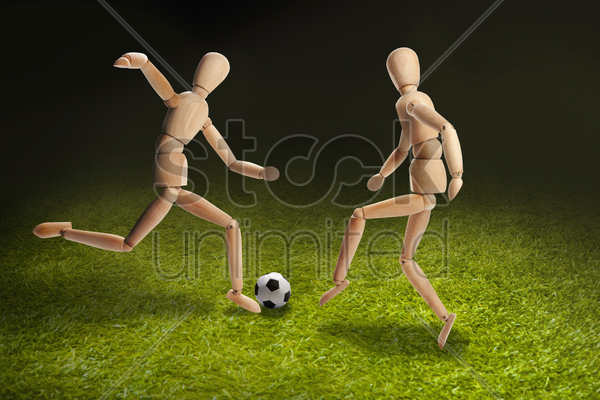 wooden dummies models playing soccer stock photo