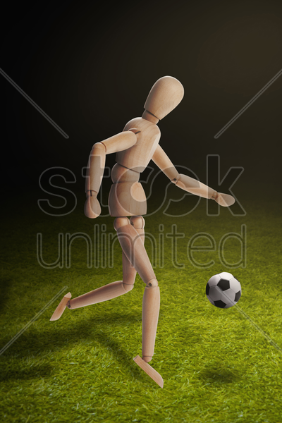wooden dummy model playing soccer stock photo