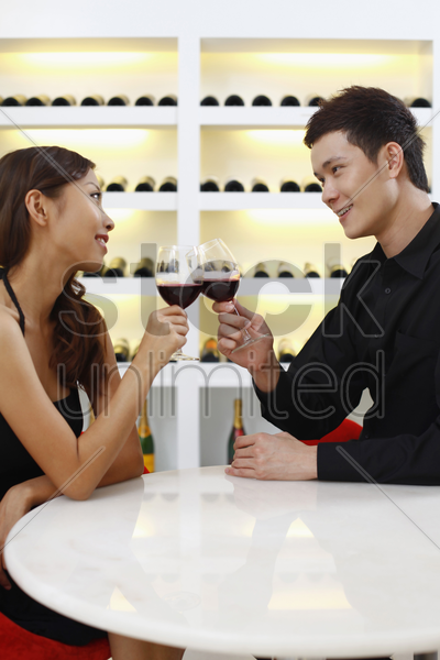 young couple toasting wine stock photo