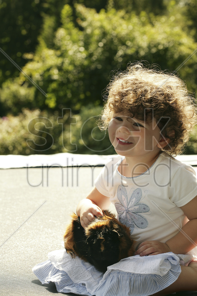 young girl with her guinea pig stock photo