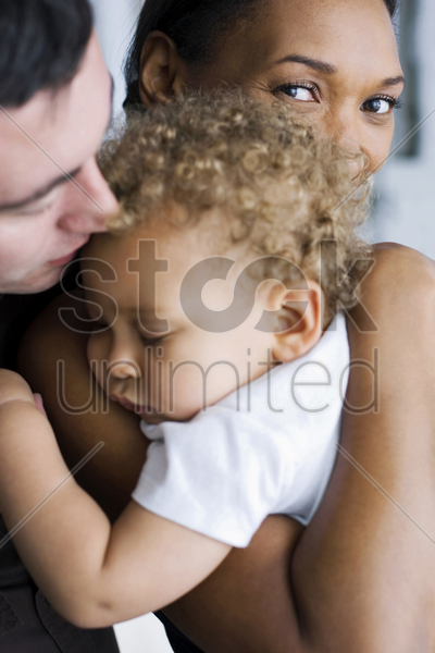 young parents and their son stock photo