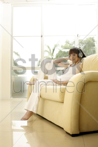 young woman listening to music stock photo
