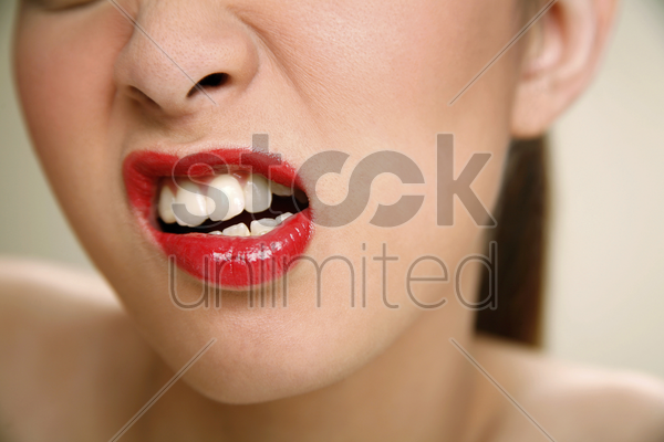 young woman with angry look stock photo