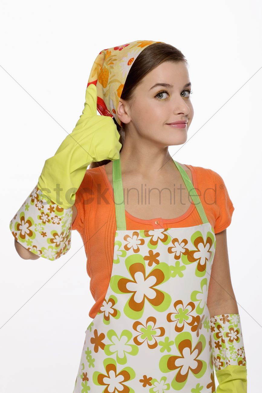 White gloves apron cleaning services - Woman In Apron Showing Hands With Rubber Gloves On Stock Photo